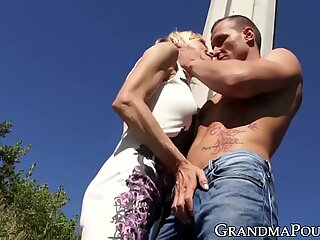 Beautiful granny rides young cock by the highway